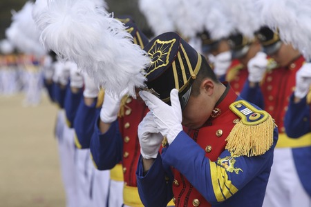 Feb 26, 2015 ? South Korea, Seoul : South Korean cadets adjusts a  cap  during a graduation ceremony of the 71st army academy at the Hwarang drill field in Seoul, South Korea, Thursday, Feb. 26, 2015. At the ceremony, 220 cadets including 19 female cadets