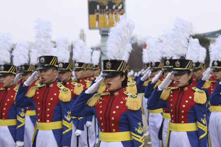 Feb 26, 2015 ? South Korea, Seoul : South Korean cadets salute  during a graduation ceremony of the 71st army academy at the Hwarang drill field in Seoul, South Korea, Thursday, Feb. 26, 2015. At the ceremony, 220 cadets including 19 female cadets, gradua