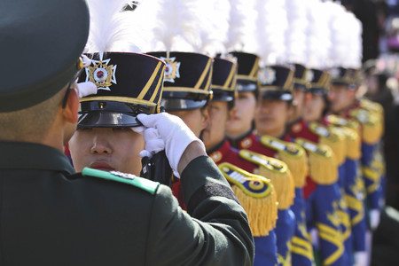Feb 26, 2015 ? South Korea, Seoul : South Korean army officer adjusts cap of a cadets  during a graduation ceremony of the 71st army academy at the Hwarang drill field in Seoul, South Korea, Thursday, Feb. 26, 2015. At the ceremony, 220 cadets including 1