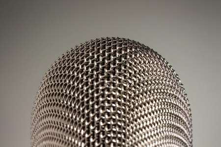 A silver microphone on white background.