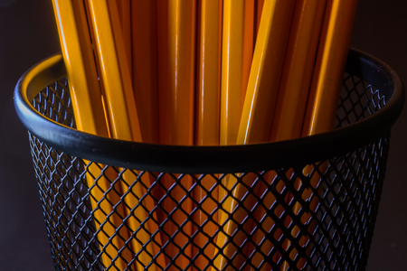 Close up image of jar with yellow pencils.