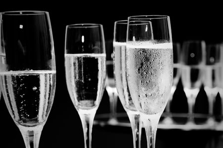 functions: black and white champagne glasses at a function.