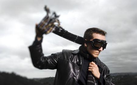 Male model poses as a pilot, selective focus photo