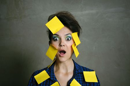 Pretty fashion model with hundreds of post it notes photo
