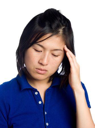 downcast: Asian girl has headache