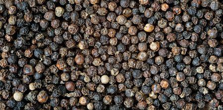 Macro detail of black peppercorns photo