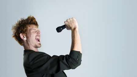 6559634: Super rock star lead singer belts out a high note