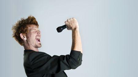 karaoke singer: Super rock star lead singer belts out a high note