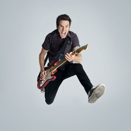 guitar player: Awesome guitar player jumps with passion in studio
