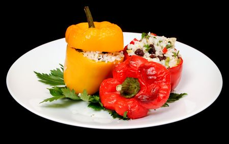 Roasted stuffed peppers sitting on a plate photo