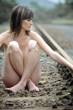 Gorgeous girl sits cross legged on a train track Stock Photo - 6559725