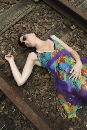 Girl lies dead on the railway tracks photo