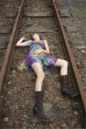 Girl lies dead on the railway tracks Stock Photo - 6559735