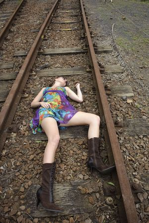 Girl lies dead on the railway tracks photo