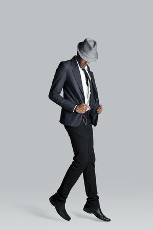 Fashion model floats off the ground in his suit photo