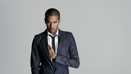 Fashion model has something in his pocket photo