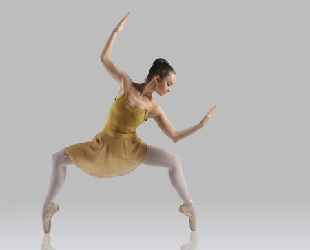 Professional female ballet dancer isolated in studio photo
