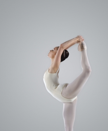 flexible: Professional female ballet dancer isolated in studio