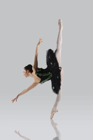 Professional female ballet dancer isolated in studio photo