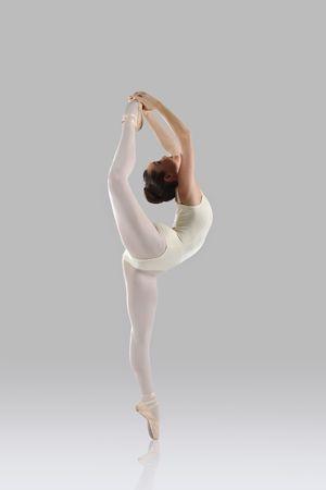 modern ballet dancer: Professional female ballet dancer isolated in studio