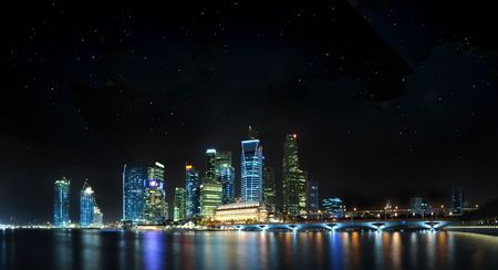 marina life: Beautiful cityscape of Singapore CBD on a clear night with stars and reflection off water.