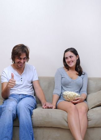 Couple watch a movie at home with popcorn Stock Photo - 6677555