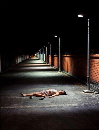 Dark and dangerous, girl sleeps in street Stock Photo - 6800698
