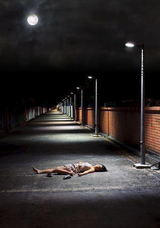 Asian girl lies in an empty street Stock Photo - 6800701
