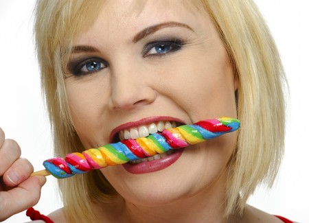 candy stick: Pretty blond enjoys her multicolored candy stick