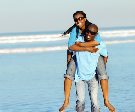 Attractive couple having fun together at the beach Stock Photo - 7259014