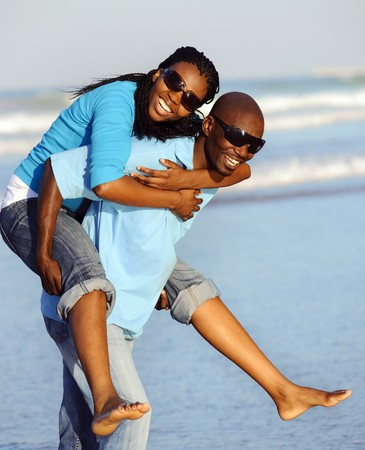 fun woman: Attractive couple having fun together at the beach Stock Photo