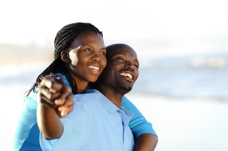 african boy: Attractive couple having fun together at the beach Stock Photo