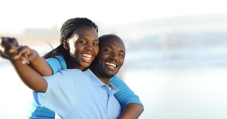 black couple: Attractive couple having fun together at the beach Stock Photo