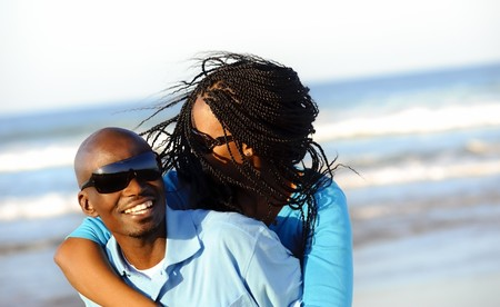 Happy African American couple enjoy the beach Stock Photo - 7258964