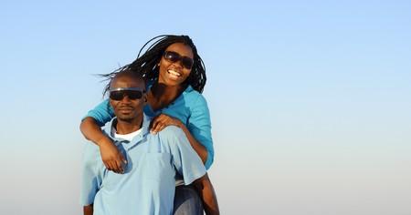 Happy African American couple enjoy the beach photo