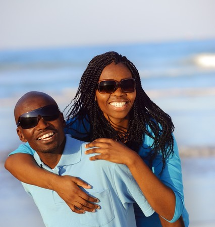 sunglasses beach: Happy African American couple enjoy the beach Stock Photo