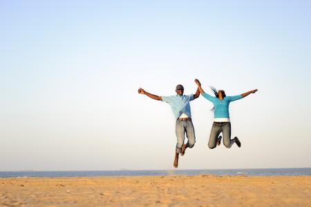 African American couple having fun at the beach photo