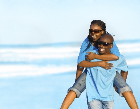 piggyback: Happy African American couple enjoy the beach Stock Photo