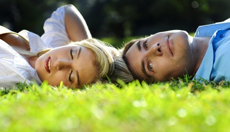 Young couple lying on the grass outside together Stock Photo - 7375434