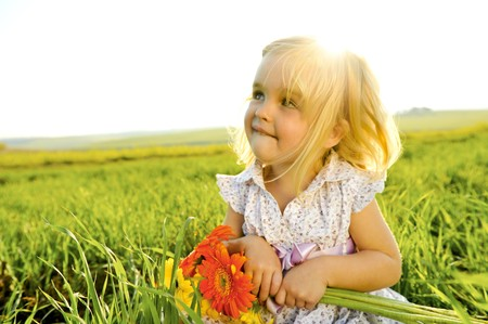 Young girl is happy outside, lens flare from the sun behind her head Stock Photo - 7378743