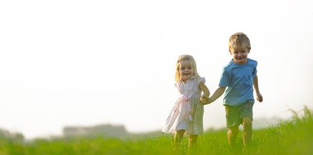 Brother and sister playing together in a field Stock Photo - 7378735