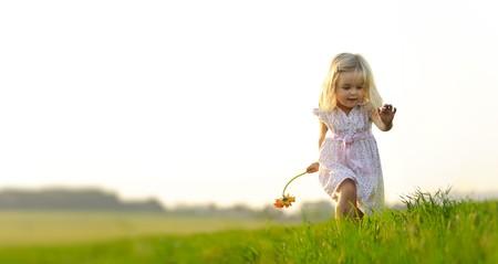 Young girl runs through a field, happy and having fun. Stock Photo - 7378730