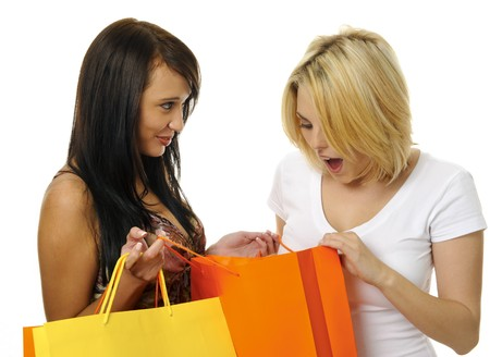 Beautiful blonde and brunette carry their shopping bags together photo