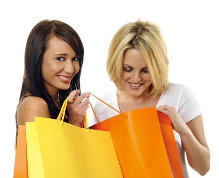 Beautiful blonde and brunette carry their shopping bags together