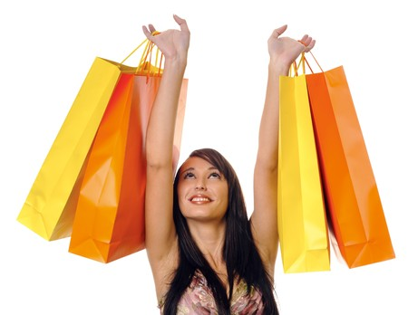 lift and carry: Gorgeous brunette girl with bright yellow and orange shopping bags Stock Photo