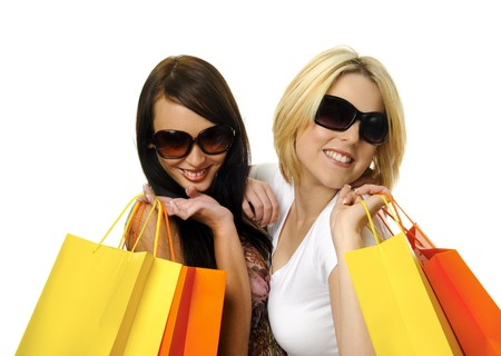 Beautiful blonde and brunette carry their shopping bags together Stock Photo - 7542115