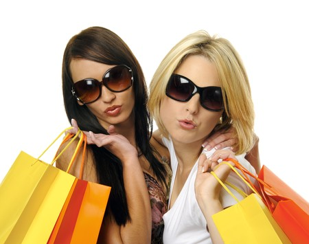 friends shopping: Beautiful blonde and brunette carry their shopping bags together