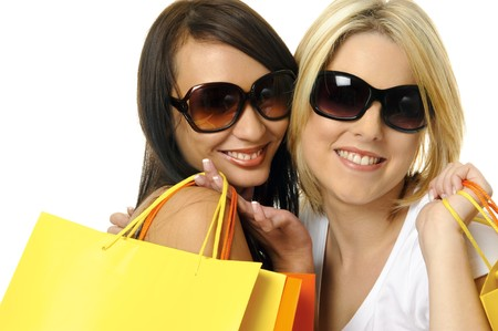 Beautiful blonde and brunette carry their shopping bags together Stock Photo - 7542134