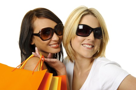 Beautiful blonde and brunette carry their shopping bags together Stock Photo - 7542133