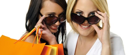 Beautiful blonde and brunette carry their shopping bags together Stock Photo - 7542118